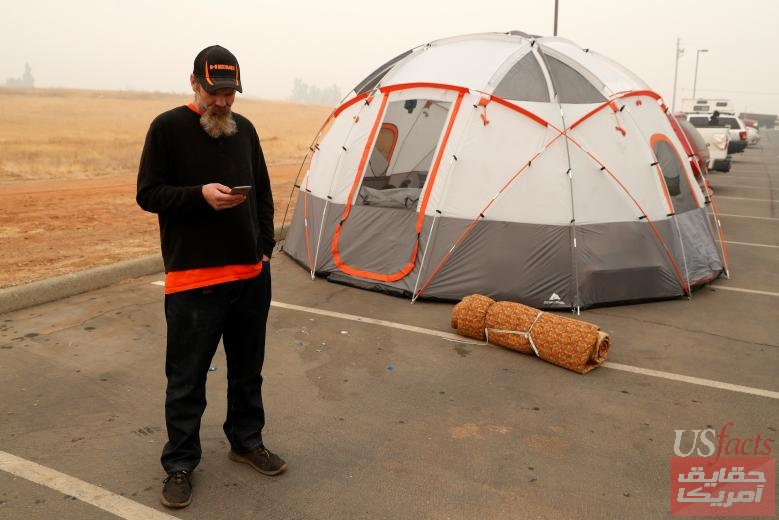 Clark stands by his tent at an evacuation center in Oroville
