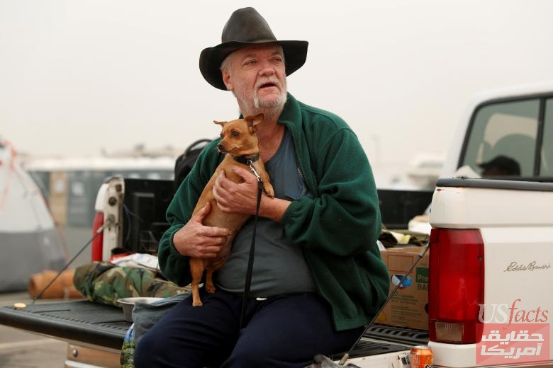 Wigham sits at an evacuation center in Oroville