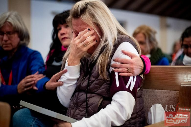 Laura Martin mourns her father, TK Huff, during a vigil for the lives and community lost to the Camp Fire at the First Christian Church of Chico in Chico