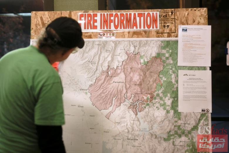 A man looks at a map of the Camp Fire at a Red Cross shelter in Chico