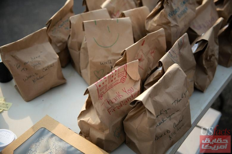 Thank you messages are written on free lunch bags for Camp Fire evacuees and first responders in Chico, California